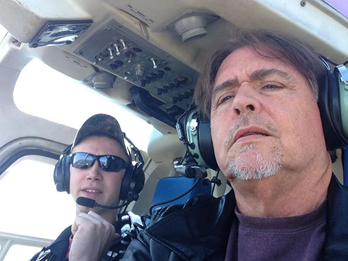 Helicopter pilot and AEF President, Al Cecere, investigate the safest route for helicopters to take so as not to disturb the nest.