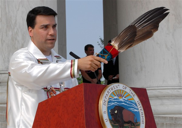 Scott Aiken of the Interior Department's Bureau of Indian Affairs performs a Native American blessing during the Bald Eagle Recovery and Final Delisting ceremony held June 28, 2007, at the Jefferson Memorial, Washington, D.C. Defense Dept. photo by Petty Officer 2nd Class Molly A. Burgess, USN