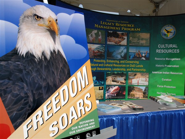 A Defense Department's Legacy Resource Management Program display shows a table of information during the Bald Eagle Recovery and Final Delisting ceremony held at the Jefferson Memorial, June 28, 2007. The display was one of many in which provided natural and cultural resource information. Photo by Petty Officer 2nd Class Molly A. Burgess, USN