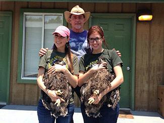 Al Cecere, Julia Cecere, & Laura Sterbens with eaglets.